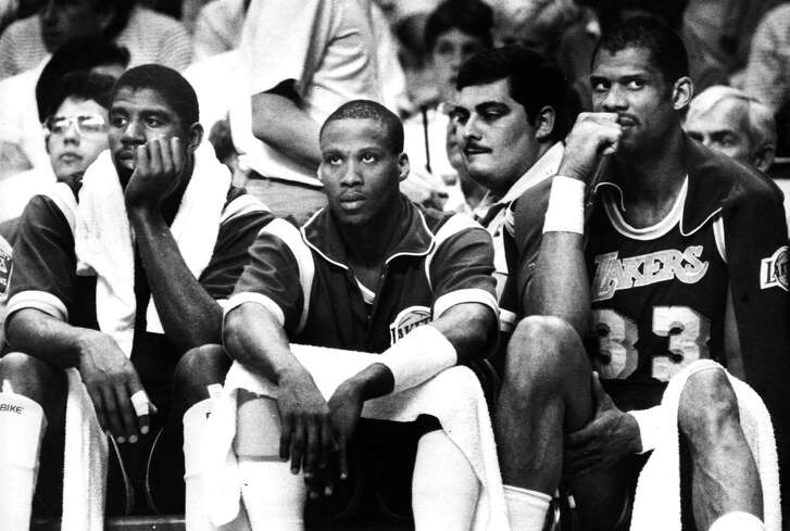 From left, Los Angeles Lakers' Magic Johnson, Byron Scott and Kareem Abdul-Jabbar react from the bench during a Lakers loss in Game One of the 1985 NBA Finals between the Boston Celtics and the Los Angeles Lakers at the Boston Garden on May 27, 1985.