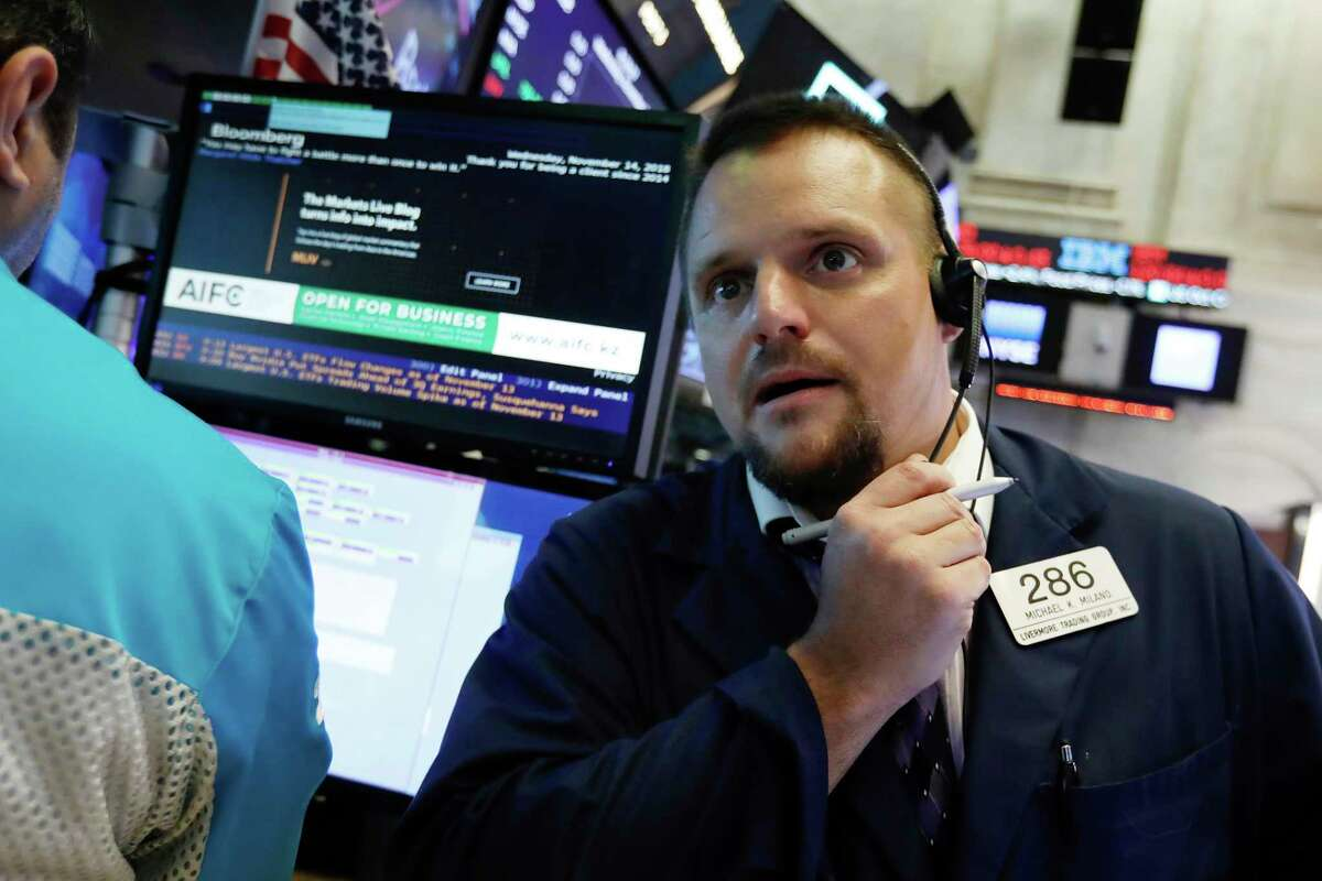 Trader Michael Milano works on the floor of the New York Stock Exchange, Wednesday, Nov. 14, 2018. Energy companies led U.S. stocks broadly higher in early trading Wednesday, wiping out some of the market's losses from a day earlier. (AP Photo/Richard Drew)