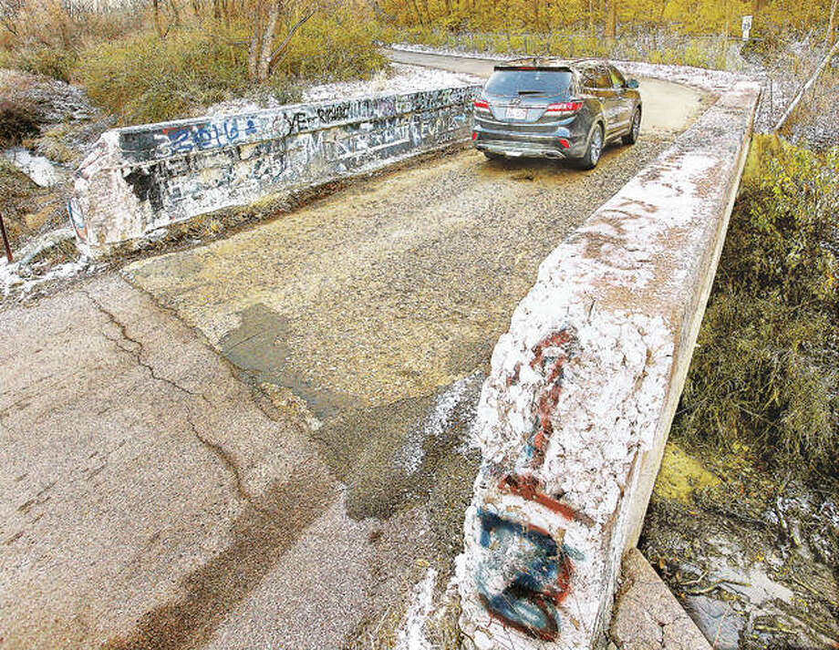 A car passes over the Albers Lane bridge from Culp Lane in Bethalto Wednesday. Officials plan to move the narrow bridge to a different location and widen it to two lanes. Photo: John Badman | The Telegraph