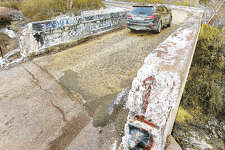 A car passes over the Albers Lane bridge from Culp Lane in Bethalto Wednesday. Officials plan to move the narrow bridge to a different location and widen it to two lanes.