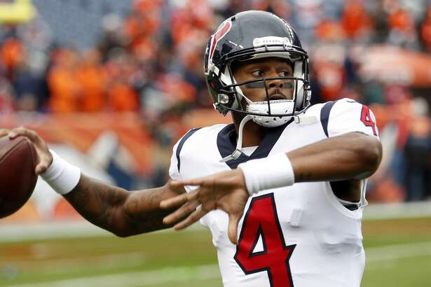 Houston Texans quarterback Deshaun Watson (4) warms up before an NFL football game against the Denver Broncos at Broncos Stadium at Mile High on Sunday, Nov. 4, 2018, in Denver.