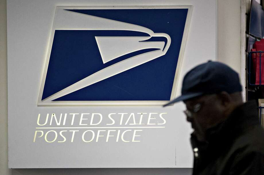 Signage is seen at the United States Postal Service (USPS) Joseph Curseen Jr. and Thomas Morris Jr. post office station in Washington, D.C., U.S., on Tuesday, Dec. 12, 2017. The USPS said it expects to deliver over 15 billion total pieces of mail this holiday season with expanded Sunday delivery operations in certain areas, delivering over six million packages each Sunday in December. Photographer: Andrew Harrer/Bloomberg ORG XMIT: 775090767 Photo: Andrew Harrer / © 2017 Bloomberg Finance LP