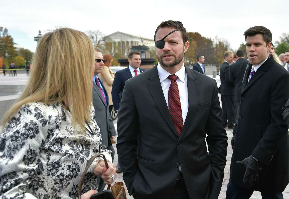 Republican House member-elect Dan Crenshaw is seen after posing for the 116th Congress members-elect group photo on the East Front Plaza of the US Capitol in Washington, DC on November 14, 2018. (Photo by MANDEL NGAN / AFP)MANDEL NGAN/AFP/Getty Images