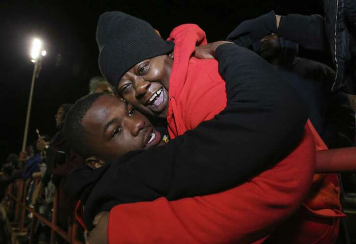 Marshall quarterback Malik Hornsby receives a hug and kiss from his mother, Seth Freeman, after winning the district title at Butler Stadium on Friday, Nov. 9, 2018, in Houston.