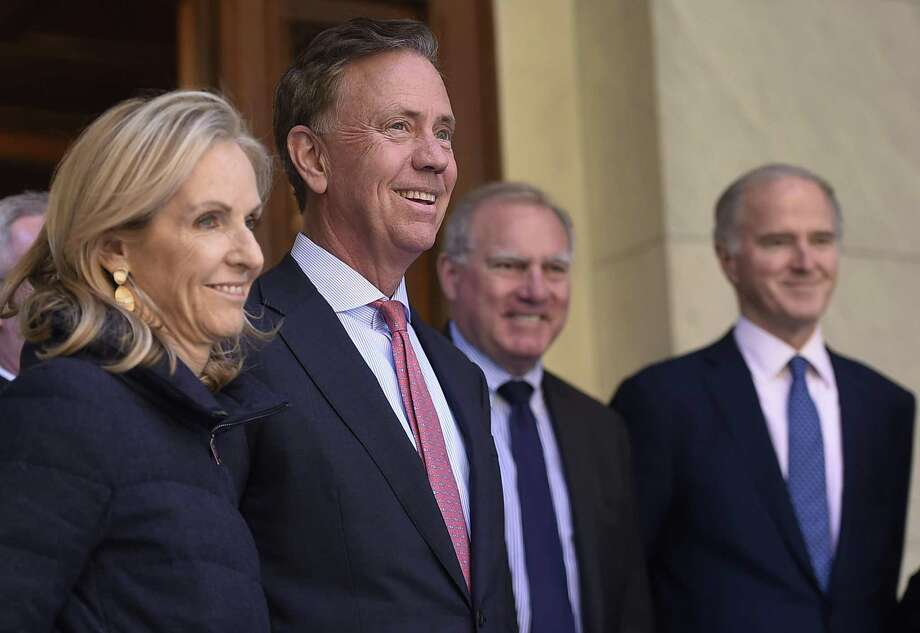 Connecticut Gov.-elect Ned Lamont smiles as he stands with wife Annie during a news conference to introduce his transition team at the State Capitol in Hartford last week. Photo: Jessica Hill / Associated Press / Copyright 2018 The Associated Press. All rights reserved