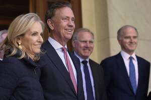 Connecticut Gov.-elect Ned Lamont smiles as he stands with wife Annie during a news conference to introduce his transition team at the State Capitol in Hartford last week.