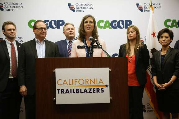 Assembly Minority Leader Kristin Olsen, R-Modesto, center, discusses the success of the party's California Trailblazers Campaign Caucus in helping Republicans achieve their goal last year of preventing Democrats from securing a two-thirds majority in both houses of the state Legislature, during a news conference at the opening day of the CRP Spring 2015 Organizing Convention in Sacramento, Calif., Friday, Feb. 27, 2015. The California Trailblazers presented a diverse slate of Republican candidates for office last year, including several Latinos and Asians, and provided logistical and fundraising help to candidates who demonstrated they had a shot at winning.