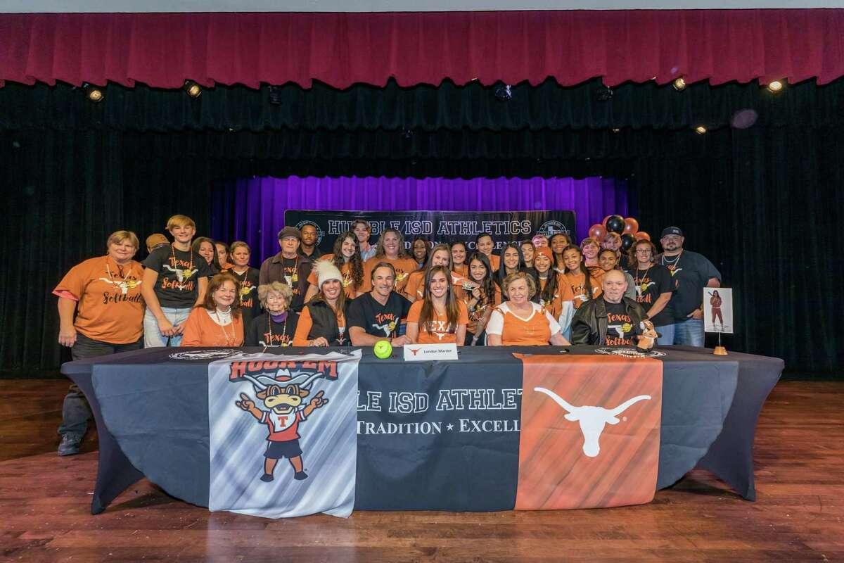 Atascocita's London Marder signs to play softball at the University of Texason National Signing Day on Thursday at Charles Bender Performing Arts Center.