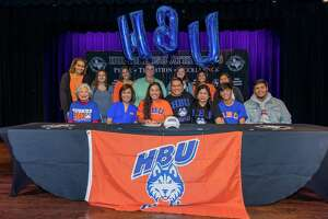 Kingwood Park's Elise Parel signs to play golf at Houston Baptist University on National Signing Day on Thursday at Charles Bender Performing Arts Center.