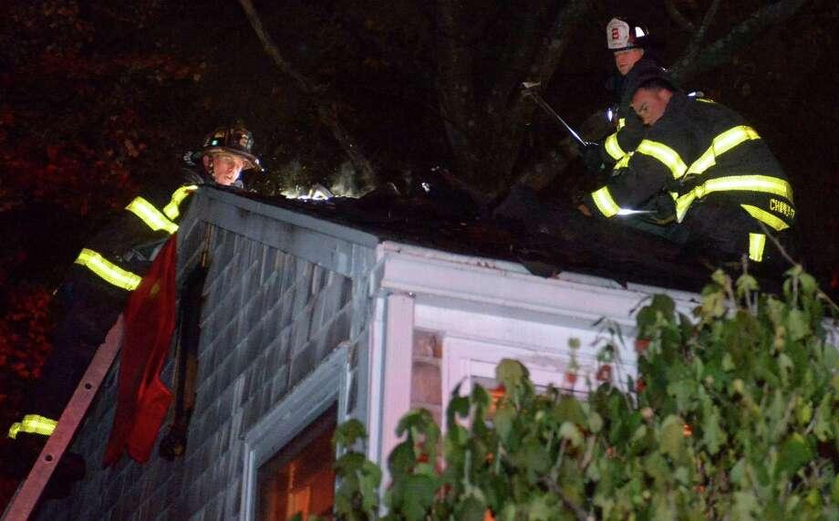Norwalk firefighters battle a blaze at Rampart Road WEdnesday, November 14, 2018, in Norwalk, Conn. Photo: Erik Trautmann / Hearst Connecticut Media / Norwalk Hour