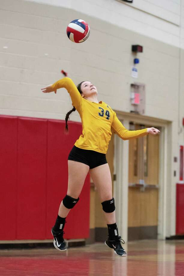 Olivia Pisano (34) of Amity, serves the ball in a Class LL Semifinal game between Amity and Westhill on November 14, 2018 at Warde High School in Fairfield, CT. Photo: John McCreary / For Hearst Connecticut Media / Connecticut Post Freelance