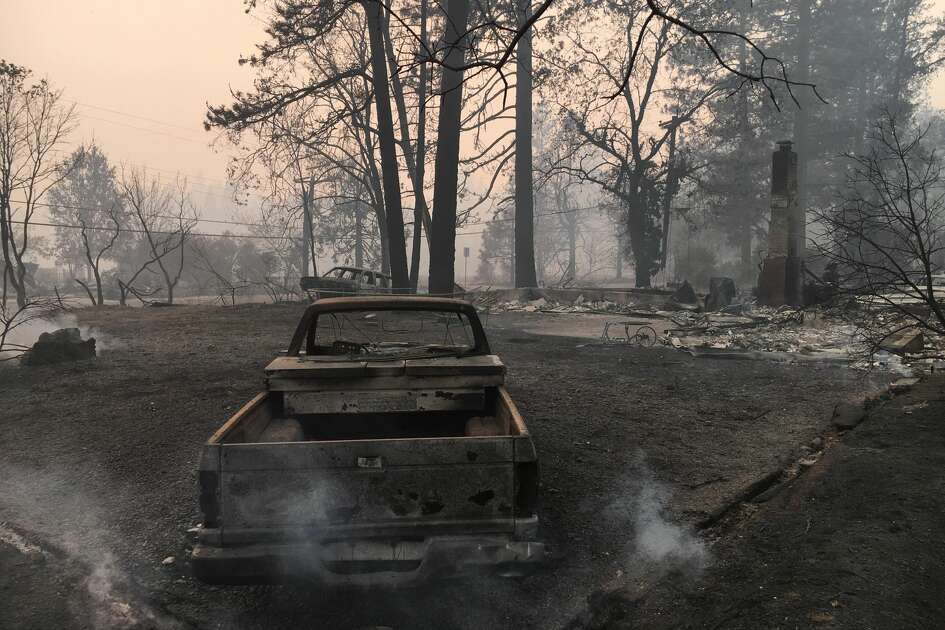 Jeff Hill shares photos of his property and cars which were burned in the Camp Fire in Paradise, Calif.