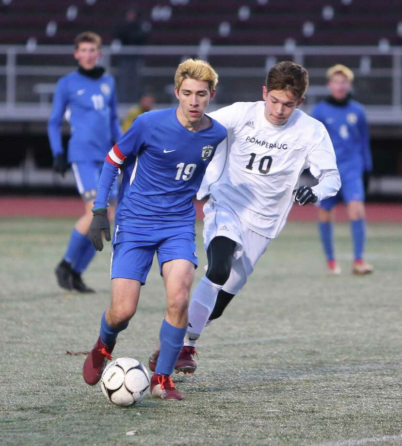 Glastonbury High School's Matthew Cosentino battles Pomperaug High School's Zachary Hoedl for the ball during the Class LL boys soccer semifinals in New Britain on Wednesday, Nov. 14, 2018. Photo: Emily J. Reynolds / For Hearst Connecticut Media / Connecticut Post Freelance