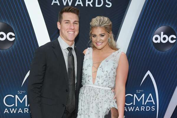 NASHVILLE, TN - NOVEMBER 14: (FOR EDITORIAL USE ONLY) Singer Lauren Alaina (R) and Alex Hopkins attend the 52nd annual CMA Awards at the Bridgestone Arena on November 14, 2018 in Nashville, Tennessee. (Photo by Jason Kempin/Getty Images)