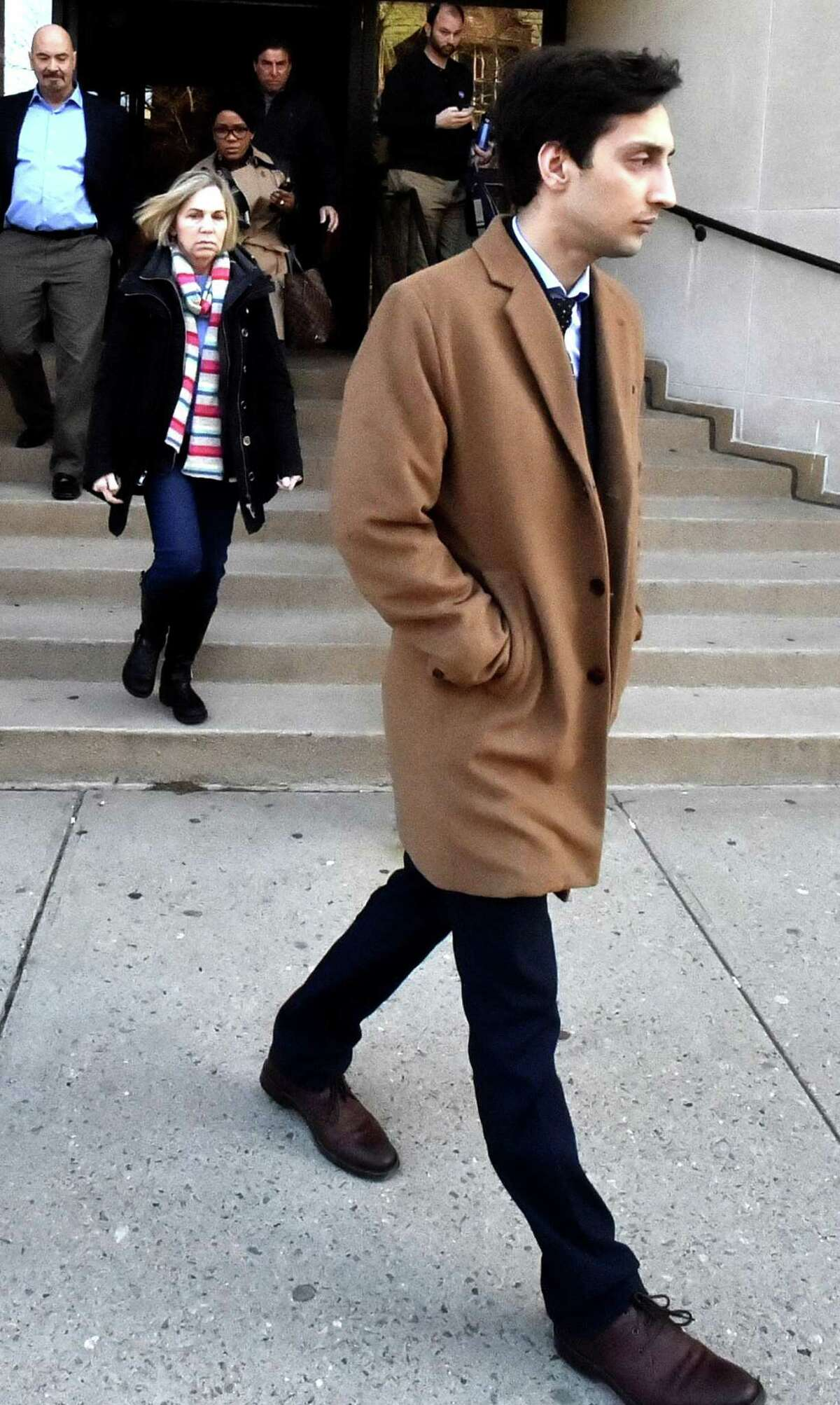 Saifullah Khan leaves Superior Court in New Haven in February.