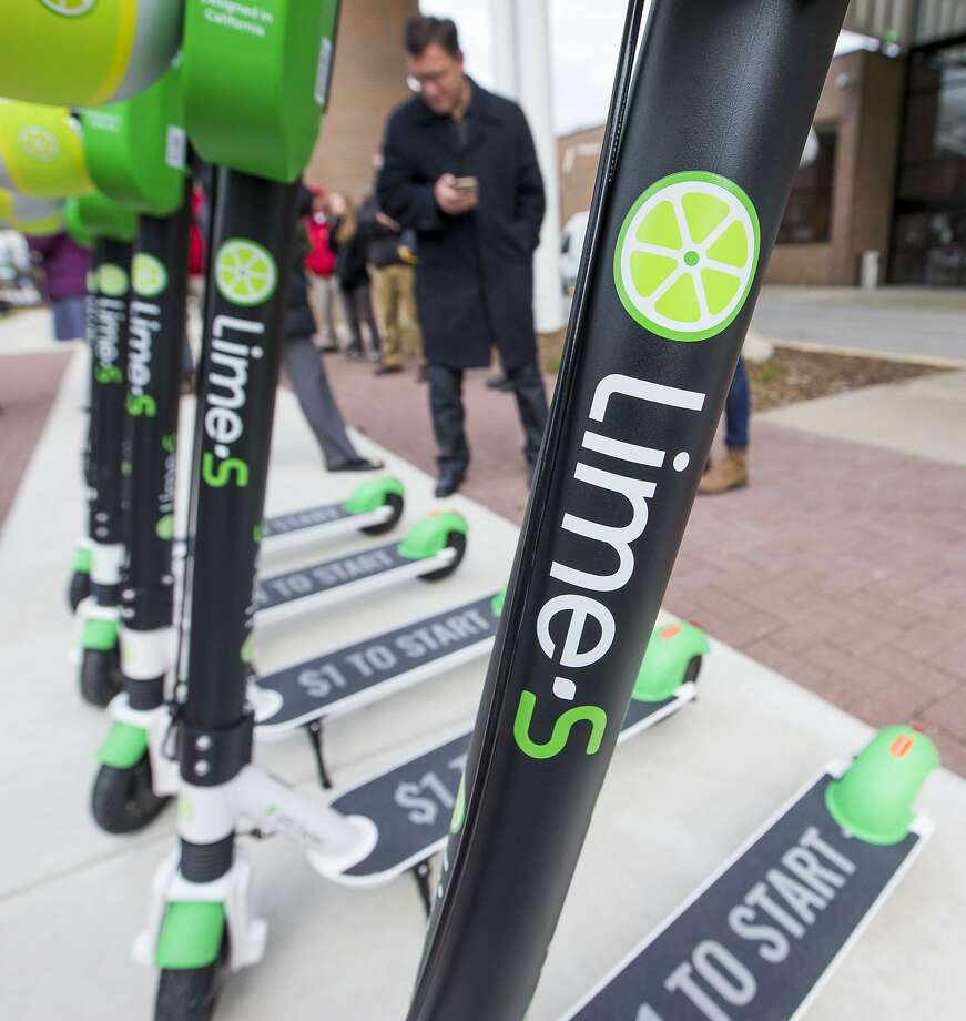 Lime releases their dockless electric scooters during a press conference on Thursday, Nov. 8, 2018, in South Bend, Ind.  Lime has received city approval to launch electric scooters on a 45-day trial basis downtown and on the Indiana University South Bend campus.(Robert Franklin/South Bend Tribune via AP) Photo: Robert Franklin, Associated Press