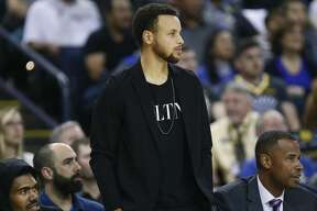 Golden State Warriors guard Stephen Curry (30) on the bench during the first half of an NBA game against the Brooklyn Nets at Oracle Arena on Saturday, Nov. 10, 2018, in Oakland, Calif.