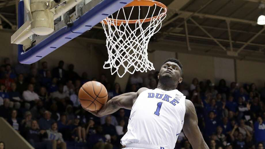 Duke freshman Zion Williamson drives for a dunk against Eastern Michigan during the second half. Photo: Gerry Broome / Associated Press