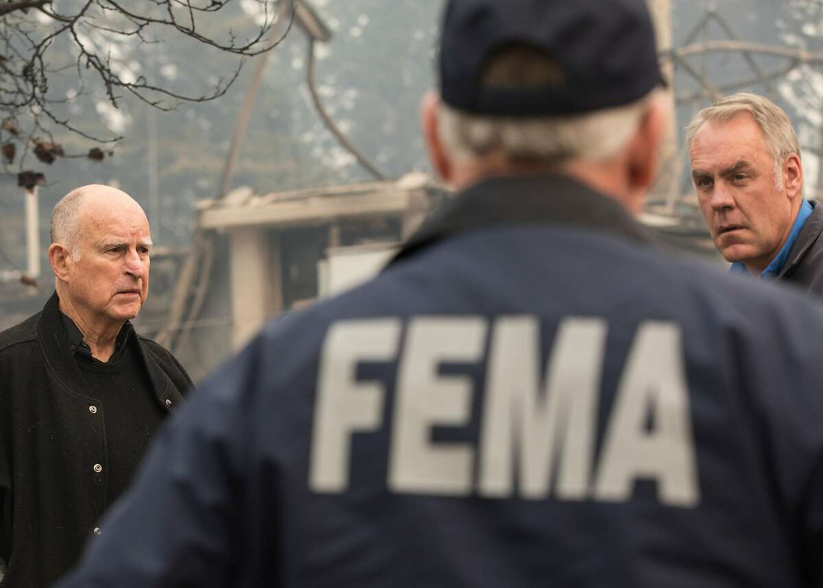 California Governor Jerry Brown (left) and U.S. Secretary of the Interior Ryan Zinke tour the rubble of Paradise Elementary School in Paradise, Calif. Wednesday, Nov. 14, 2018 after the Camp Fire destroyed the school and most of the town.