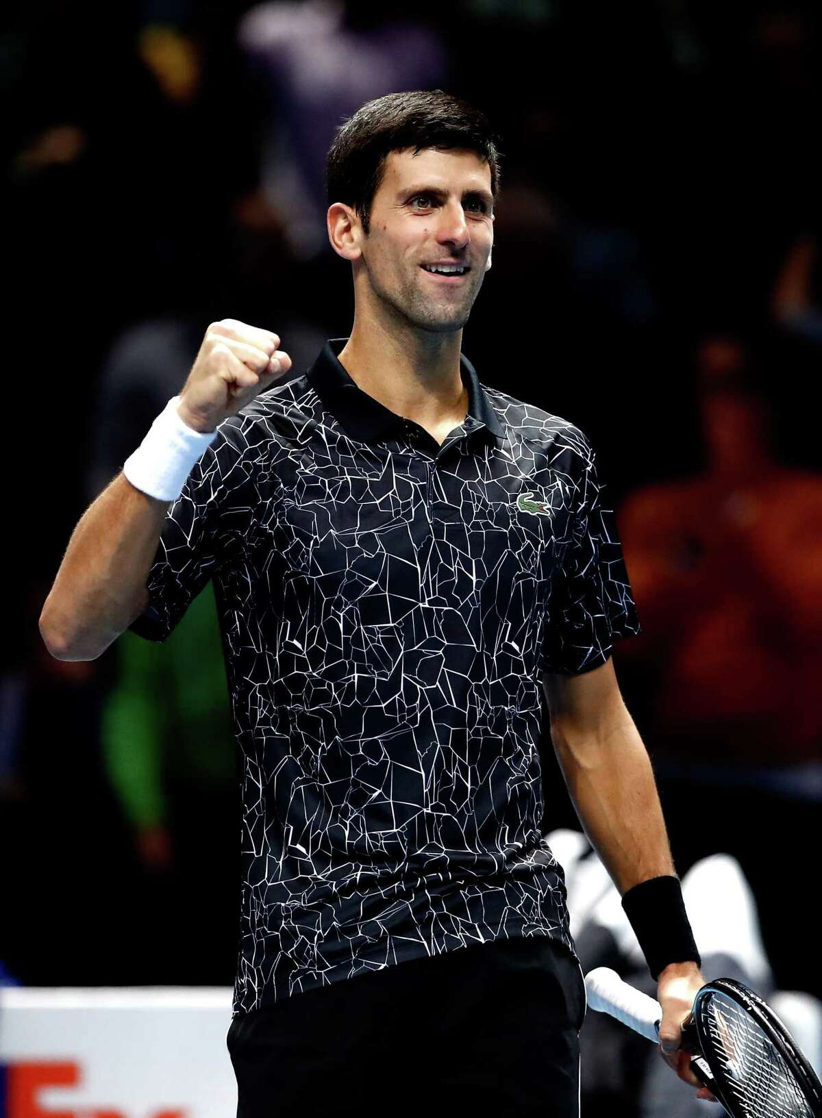 LONDON, ENGLAND - NOVEMBER 12: Novak Djokovic of Serbia celebrates victory during his singles round robin match against John Isner of The United States during Day Two of the Nitto ATP World Tour Finals at The O2 Arena on November 12, 2018 in London, England. (Photo by Julian Finney/Getty Images)