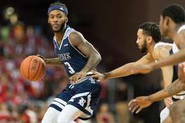 Ako Adams (3) of the Rice Owls brings the ball up the court in the first half against the Houston Cougars in a college basketball game on Wednesday, November 14, 2018 at H&PE Arena in Houston Texas.