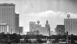 Rural and urban life collide in this photo of the Houston skyline. This photo originally appeared in the Feb. 26, 1967, issue of Texas Magazine.