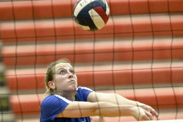 Darien's Lindsay Bennett (5) bumps the ball in the girls Class LL Semi-Finals volleyball game between Southington and Darien high schools, Wednesday night, November 14, 2018, at Shelton High School, Shelton, Conn.
