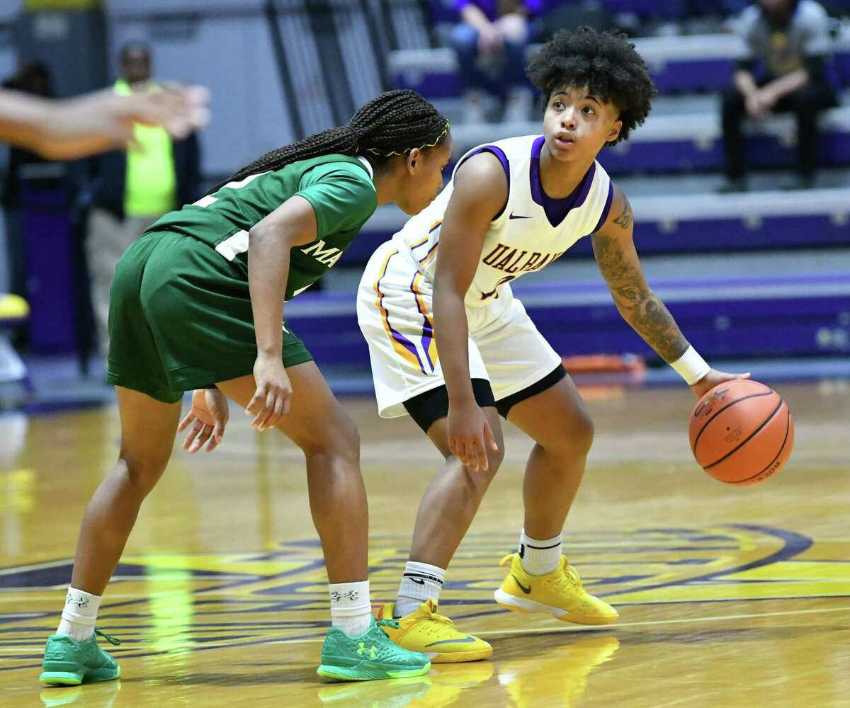 UAlbany's Kyara Frames is guarded by Manhattan's Gabby Cajou during a home opener game at SEFCU Arena on Wednesday, Nov. 14, 2018 in Albany, N.Y. (Lori Van Buren/Times Union)