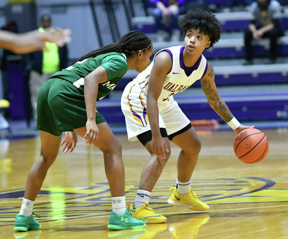 UAlbany's Kyara Frames is guarded by Manhattan's Gabby Cajou during a home opener game at SEFCU Arena on Wednesday, Nov. 14, 2018 in Albany, N.Y. (Lori Van Buren/Times Union) Photo: Lori Van Buren / 20045440A