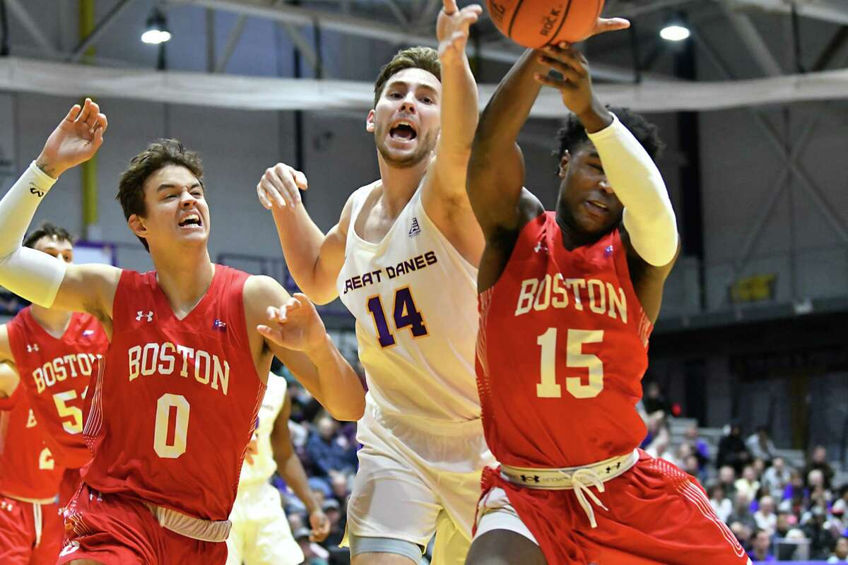 UAlbany's Adam Lulka, #14, goes after a loose ball with Boston University's Jordan Guest, #0, and Jonas Harper, #15, during a basketball game at SEFCU Arena on Wednesday, Nov. 14, 2018 in Albany, N.Y. (Lori Van Buren/Times Union)