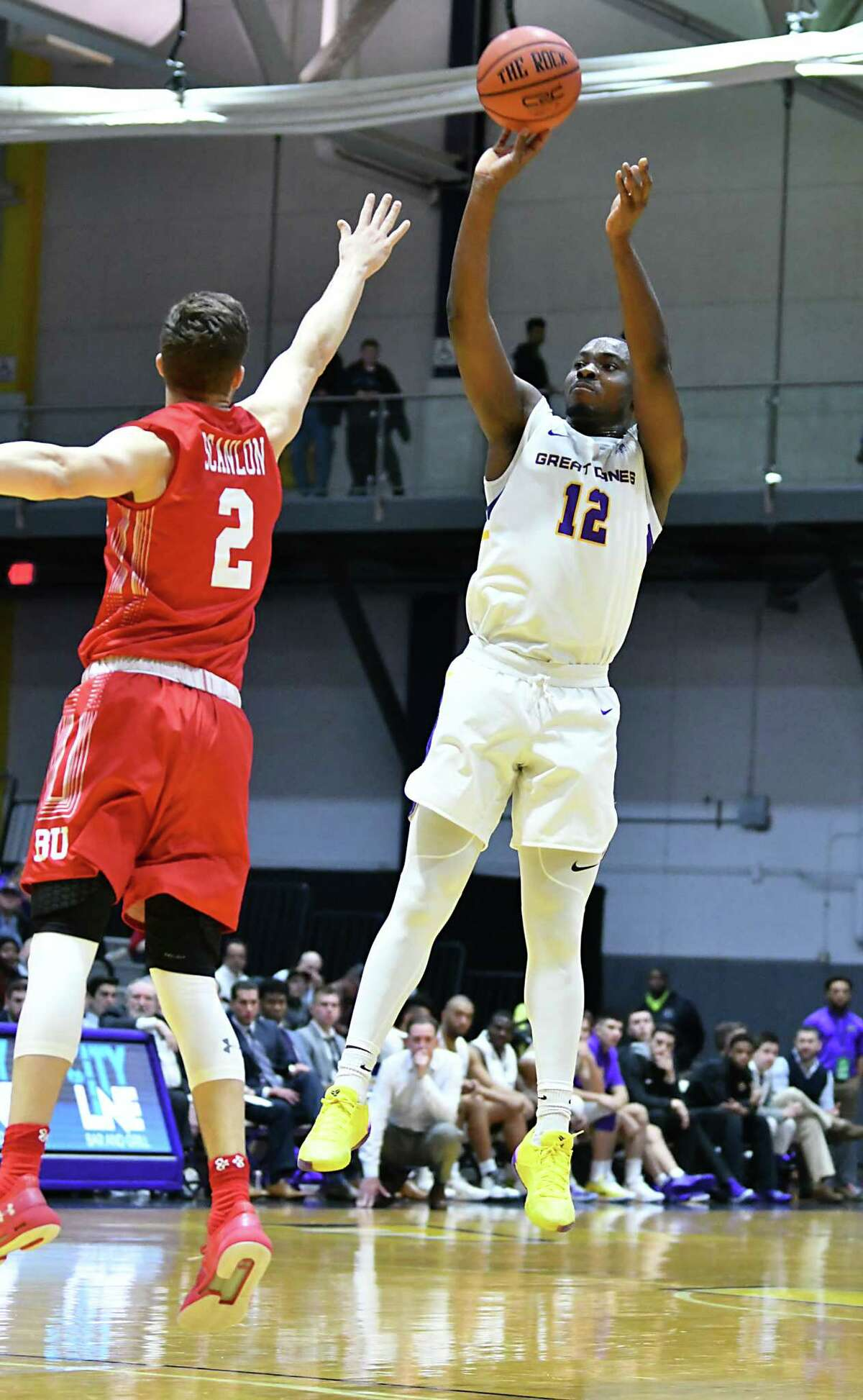 UAlbany's Devonte Campbell takes a jump shot guarded by Boston University's Tyler Scanlon during a basketball game at SEFCU Arena on Wednesday, Nov. 14, 2018 in Albany, N.Y. (Lori Van Buren/Times Union)