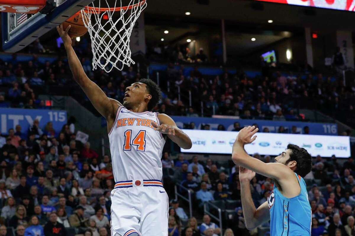 New York Knicks guard Allonzo Trier (14) goes to the basket in front of Oklahoma City Thunder guard Alex Abrines (8) during the first half of an NBA basketball game in Oklahoma City, Wednesday, Nov. 14, 2018. (AP Photo/Alonzo Adams)