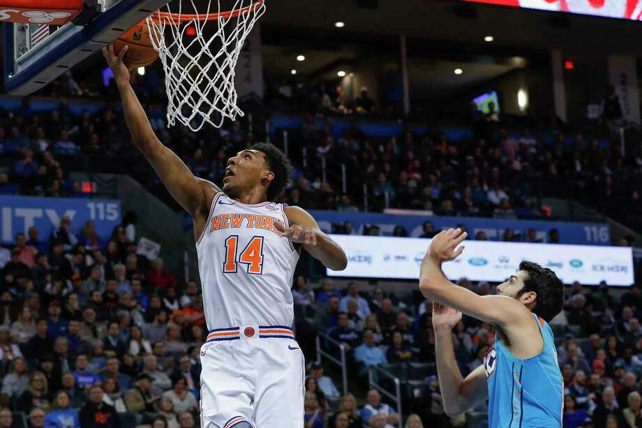 New York Knicks guard Allonzo Trier (14) goes to the basket in front of Oklahoma City Thunder guard Alex Abrines (8) during the first half of an NBA basketball game in Oklahoma City, Wednesday, Nov. 14, 2018. (AP Photo/Alonzo Adams) Photo: Alonzo Adams / Copyright 2018 The Associated Press. All rights reserved.