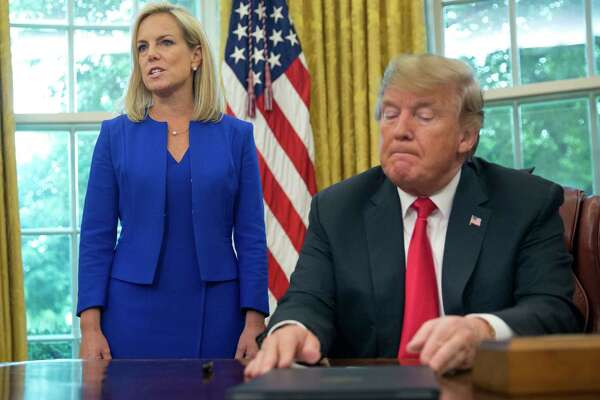 FILE - In this June 20, 2018, file photo, President Donald Trump, right, listens as Homeland Security Secretary Kirstjen Nielsen, left, addresses members of the media before Trump signs an executive order to end family separations at the border, during an event in the Oval Office of the White House in Washington. Trump and Nielsen never did quite click personally as the president chafed at her explanations of complicated immigration issues and her inability to bring about massive changes at the U.S.-Mexico border With Nielsen's departure now considered inevitable, her eventual replacement will find there's no getting around the immigration laws and court challenges that have thwarted the president's hardline agenda.