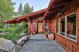 A long walkway leads to the front door of the Squaw Valley home.