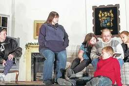 "Members of the cast of ""A Rented Christmas"" rehearse ahead of this weekend's run at Beardstown Grand Opera House."