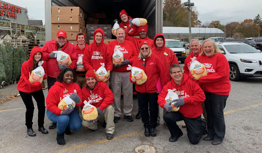 Employees from Stew Leonard's in Norwalk participated in the 39th annual Turkey Brigade on November 15, 2018. Each year, Stew's gives away 2,500 turkeys to local charity organizations and churches. Photo: Stew Leonard's