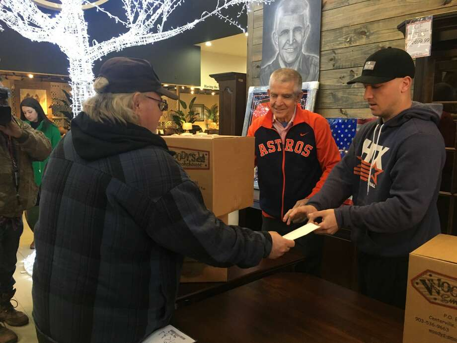 "On Thursday, November 15, 2018 Houston Astros third baseman Alex Bregman and Gallery Furniture's Jim ""Mattress Mack"" McIngvale handed out 500 free Thanksgiving turkeys to Houstonians at McIngvale's North Freeway store. Photo: Julie Takahashi, Houston Chronicle"
