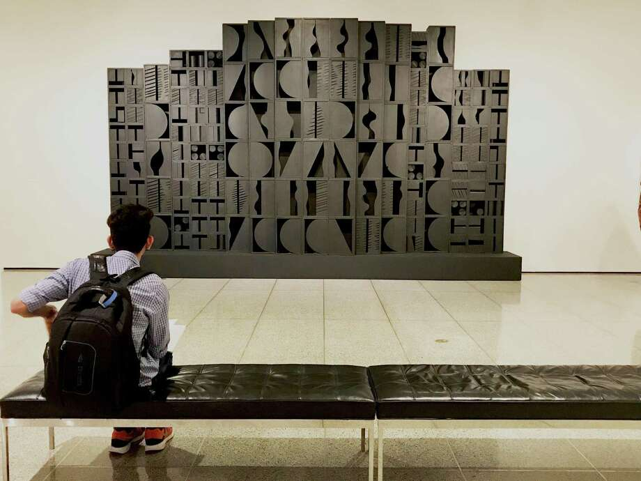 "Louise Nevelson's ""Mirror Image I"" dominates the entry wall of the show ""Kindred Spirits."" Photo: Molly Glentzer / Houston Chronicle"
