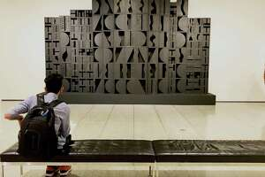 "Louise Nevelson's ""Mirror Image I"" dominates the entry wall of the show ""Kindred Spirits."""
