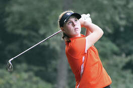 Edwardsville freshman Riley Lewis watches her iron shot during a regular-season match for the Tigers. Lewis is the Intelligencer's MVP for girls' golf.