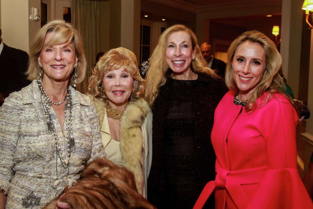 Susan Mackie, from left, Joanne King Herring, Cindi Colvin and Christie Sullivan at the Touchdown for TEACH dinner at River Oaks Country Club.