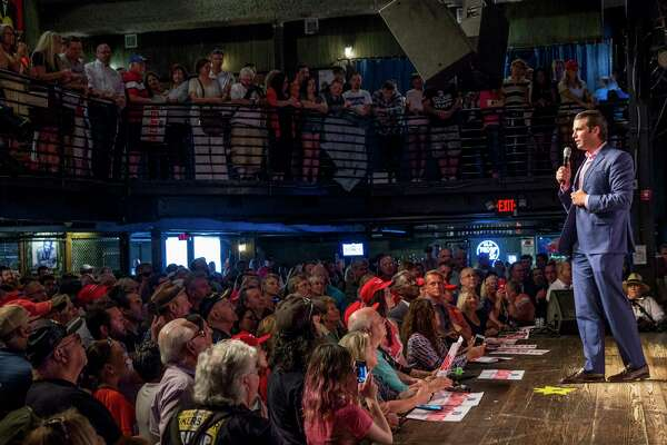 Donald Trump Jr. addresses a standing-room-only crowd at a July rally for Republican Ron DeSantis's Florida gubernatorial campaign in Orlando. He has made at least two dozen campaign stops for Republican candidates this year.