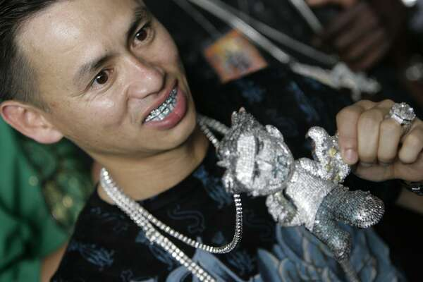Johnny Dang, a jeweler who makes most grills and chains for rappers, is seen on the red carpet before the start of the Third Annual Ozone Awards at the George R Brown Convention Center in 2008.