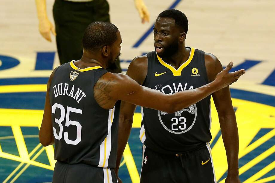 Kevin Durant #35 of the Golden State Warriors talks with Draymond Green #23 against the Cleveland Cavaliers in Game 2 of the 2018 NBA Finals at ORACLE Arena on June 3, 2018 in Oakland, California.  Photo: Lachlan Cunningham / Getty Images 2018