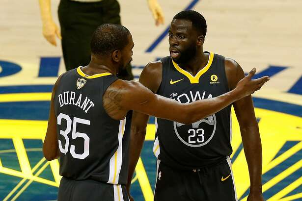 OAKLAND, CA - JUNE 03: Kevin Durant #35 of the Golden State Warriors talks with Draymond Green #23 against the Cleveland Cavaliers in Game 2 of the 2018 NBA Finals at ORACLE Arena on June 3, 2018 in Oakland, California. NOTE TO USER: User expressly ackno