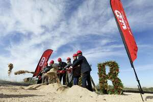 "City and county officials and H-E-B managers participate in a Thursday groundbreaking ceremony for H-E-B's 1.6-million-square-foot ""Super Regional Grocery Warehouse"" on Foster Road on the city's far East Side. It will be the San Antonio-based grocery chain's largest warehouse facility."