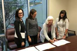 Memorial Assistance Ministries recently joined forces withLiteracy Advance of Houston. In making the joint effort official, from left to right, areLiteracy Advance Board President Robin Tooms, Literacy Advance CEO Melanie Fisk, MAM President & CEO Martha Macris, and MAM Board Chair Wendy Moreland.
