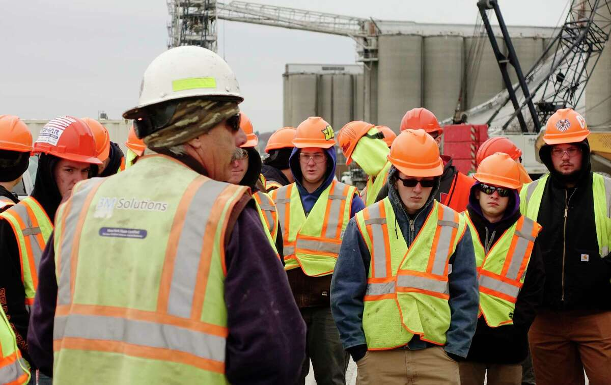 Harrison and Burrowes Bridge Constructors project superintendent, Michael Booth, foreground, talks to High School students from the Capital Region BOCES Schoharie campus during a tour of a construction site at the Port of Albany on Thursday, Nov. 15, 2018, in Albany, N.Y. (Paul Buckowski/Times Union)