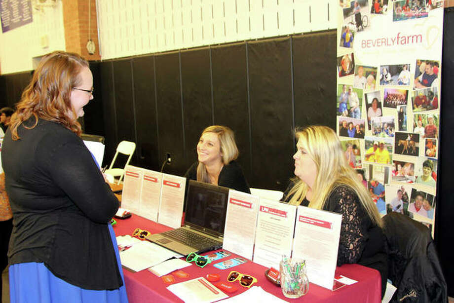 Southwestern Illinois College (SWIC) students, veterans and members of the community explored career opportunities at the Fall 2018 Job Fair at the SWIC Belleville Campus. Seeking information about a possible future career, Caryn Carl of Collinsville, (left) talks with Ashley Sliment, (center) and Becky Seymore of Beverly Farm Foundation of Godfrey. More than 300 job seekers turned out to meet more than 130 employers representing a variety of Metro East and St. Louis career fields. The fair, sponsored by SWIC Career Services, included career fields such as education, nonprofit, financial services, health care, insurance, security, law enforcement, retail sales and more. Photo: Courtesy Of Jim Haverstick | For The Intelligencer